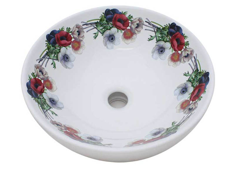 Red, white and purple pansies painted on a white vessel sink
