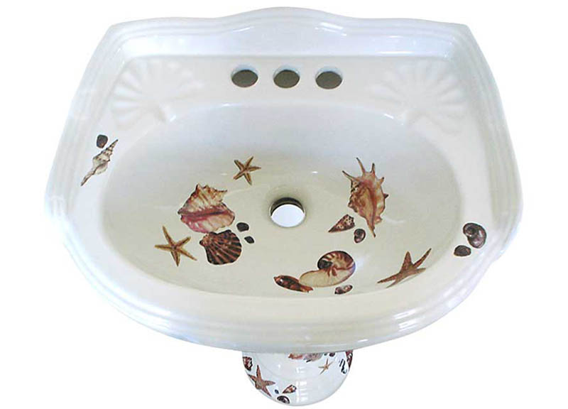Hand painted sea shells design on a white pedestal sink.