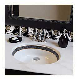 gold and black bathrom with black marble border painted sink