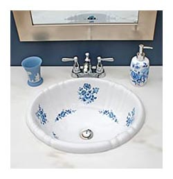 Blue and white powder room with blue roses painted sink and wedgewood cup