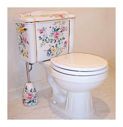 chintz and gold floral hand painted toilet with matching accessories