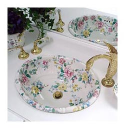 chintz painted floral sink in white master bath with swan faucet