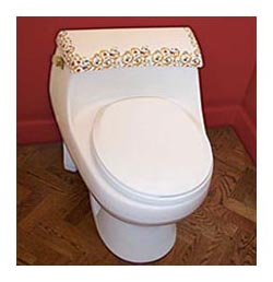 ornate florentine design in gold red and blue hand painted toilet in red powder room