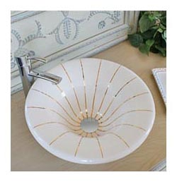 Gold lines painted on a biscuit vessel sink in country french powder room
