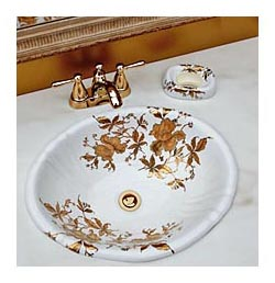 Gold and marble bathroom with gold orchid painted vanity sink