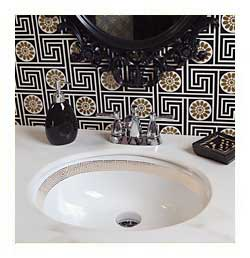 Black and gold bathroom with gold greek key hand border painted sink