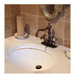 gold rope border painted vanity basin in beige tumbled stone bathroom