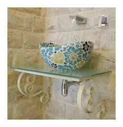 custom turquoise blue and green painted floral vessel sink in stone bathroom with glass vanity top