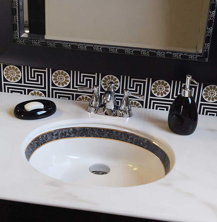Faux Black marble painted sink in black and gold bathroom