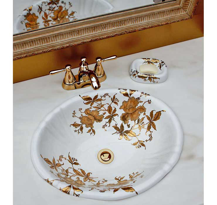 Gold Orchids painted on a white fluted drop-in sink in gold powder room